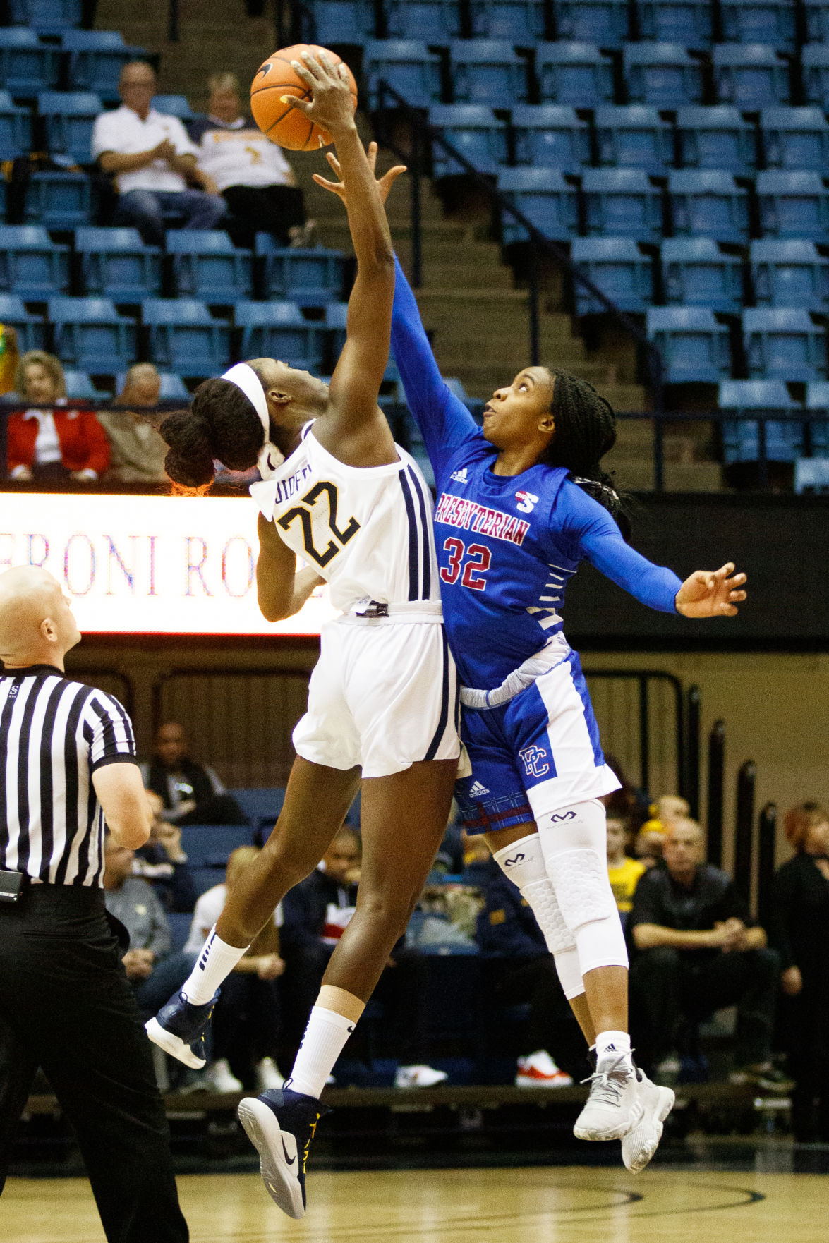 West Virginia's Blessing Ejiofor and Presbyterian's jade Compton reach for the opening tip-off during West Virginia's game against Presbyterian on Nov. 10, 2019 at the Coliseum.