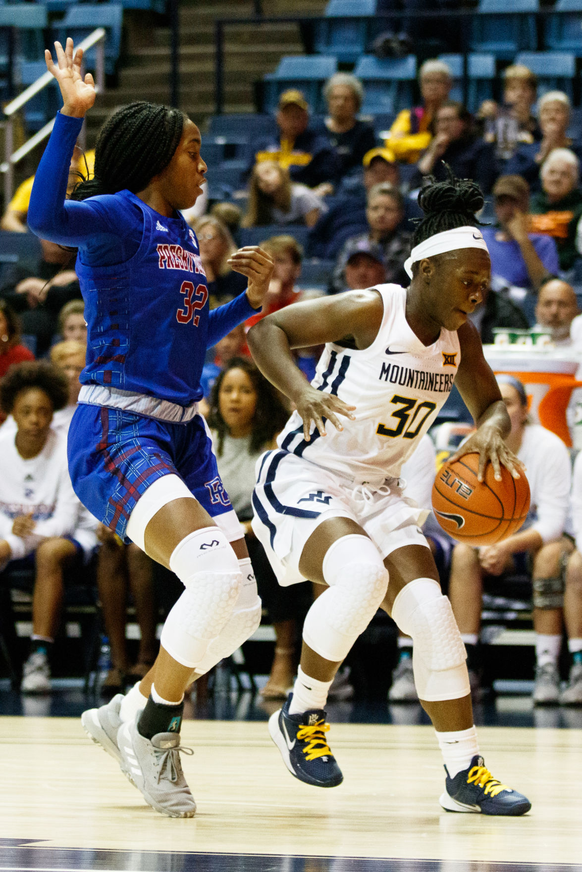 West Virginia's Madisen Smith charges towards the basket Presbyterian's Jade Compton defends during West Virginia's game against Presbyterian on Nov. 10, 2019 at the Coliseum.