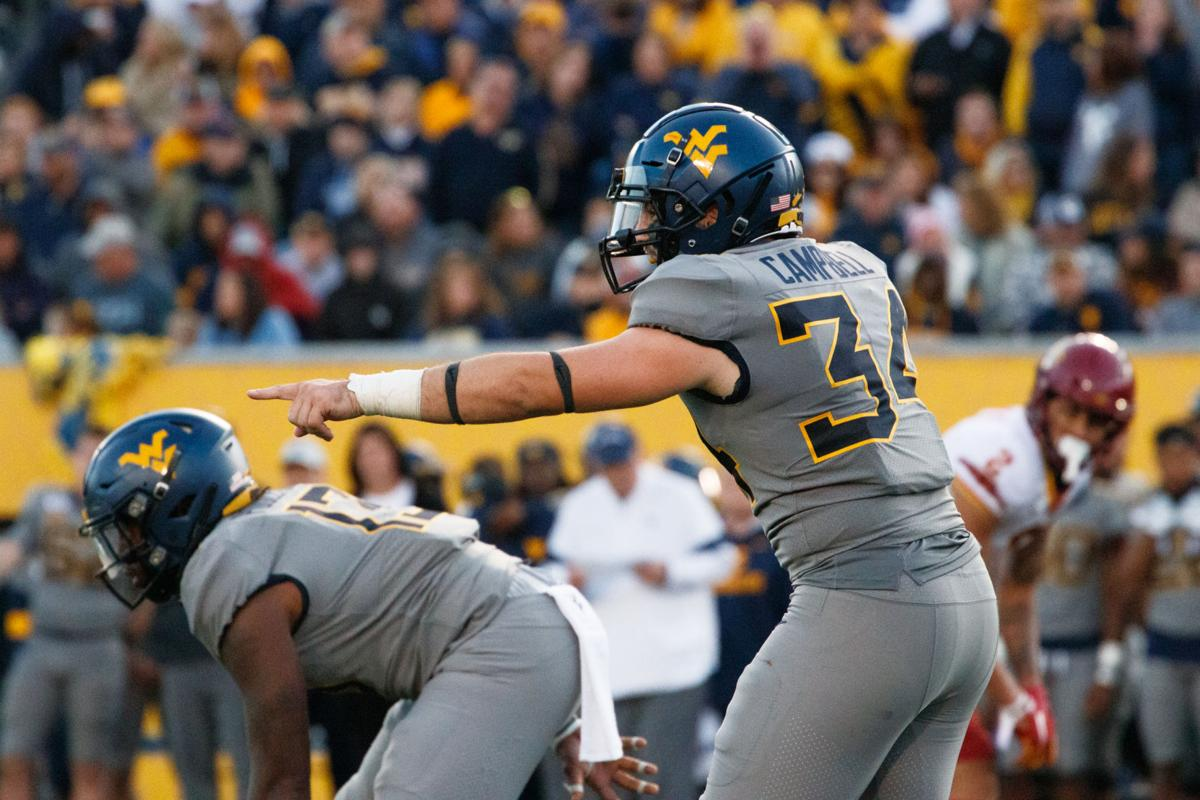 October 12, 2019: West Virginia's Shea Campbell motions to a teammate during the Mountaineers' 38-14 loss to Iowa State.