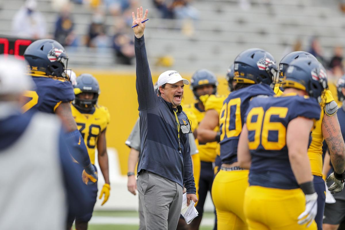 West Virginia Mountaineers head coach Neal Brown yells out a fourth down call during the Spring Game at Milan Puskar Stadium on April 24, 2021.