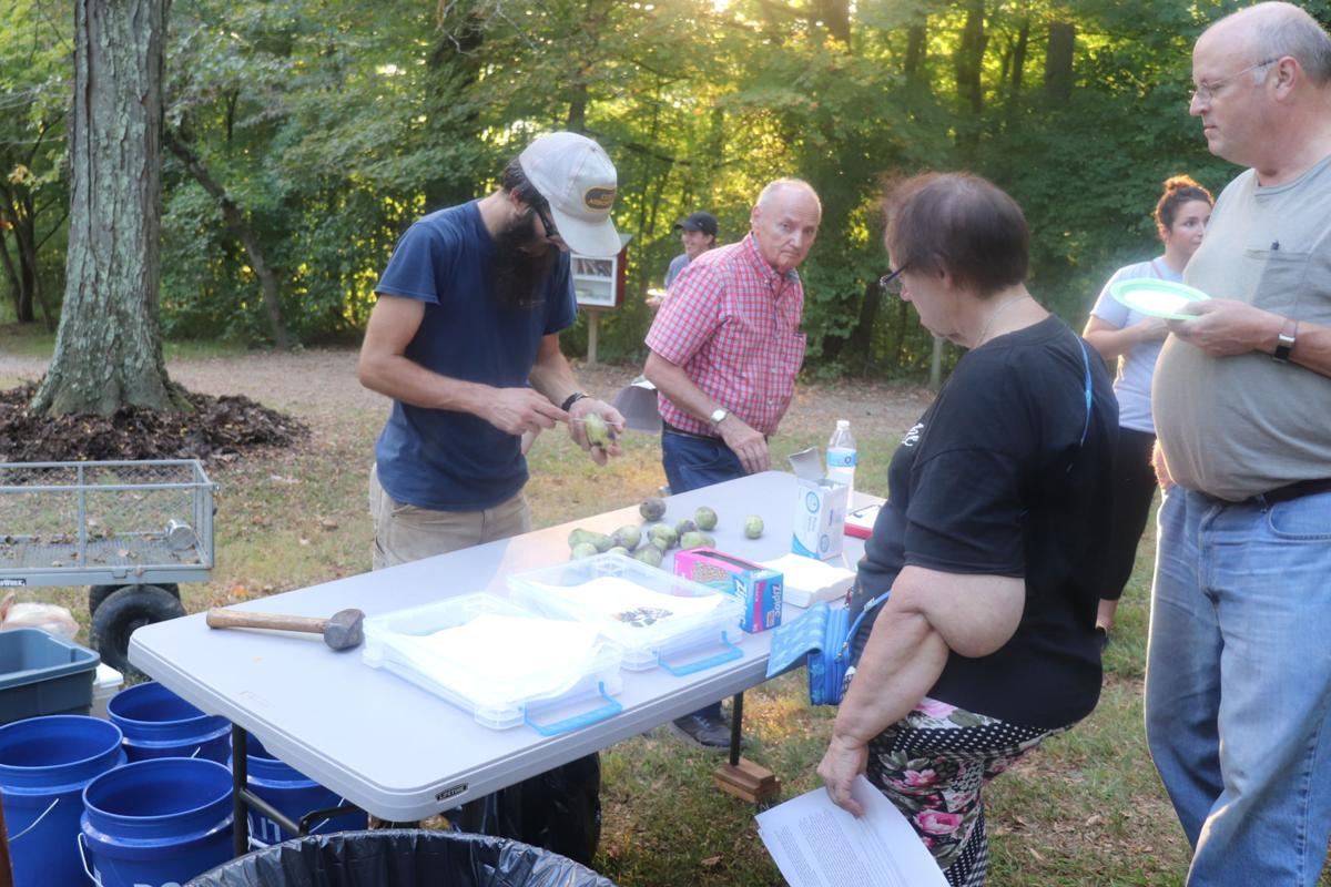 People line up to try the Appalachian Fruit at the Pawpaw Party hosted by the Core Arboretum on Sept. 12.