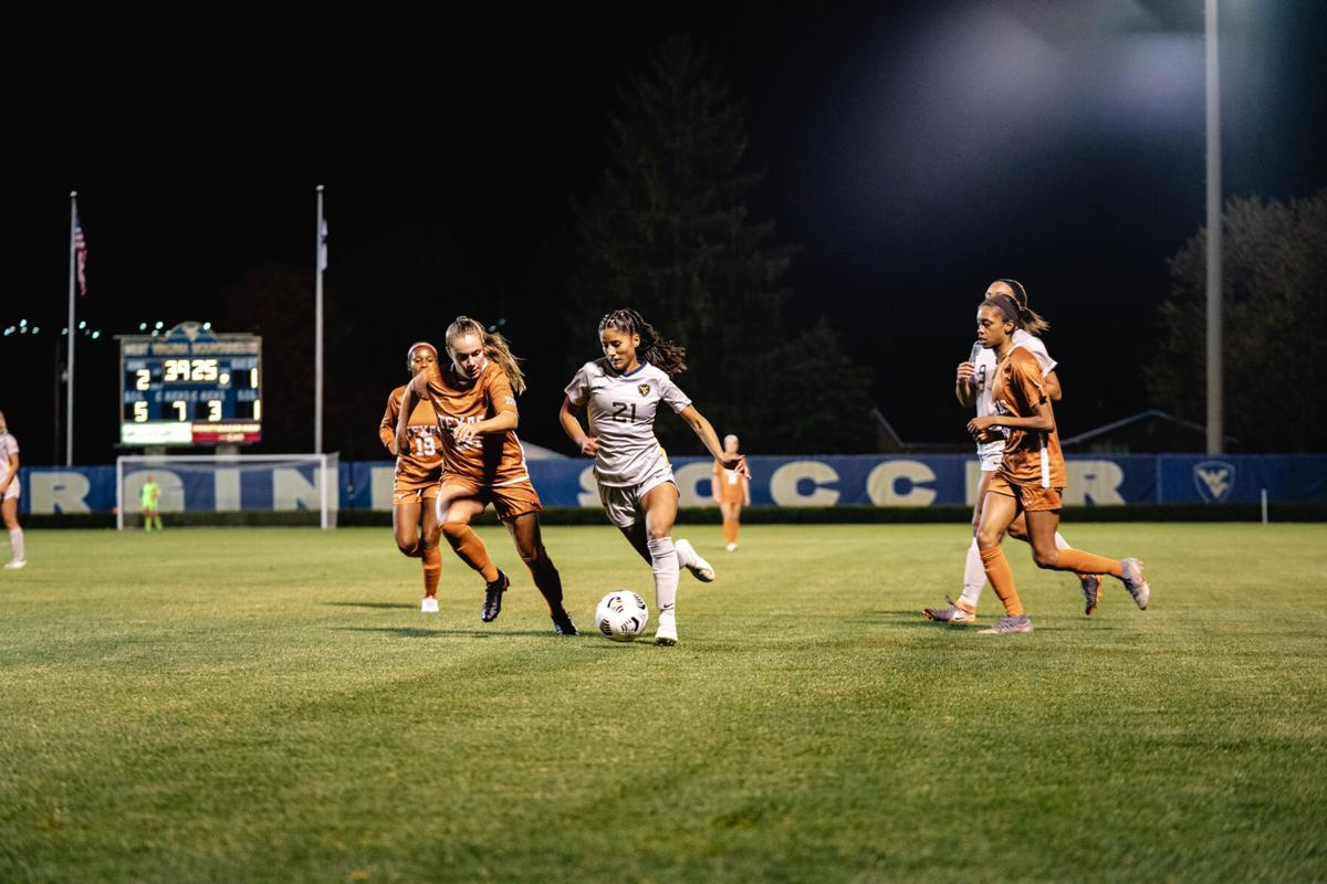 WVU midfielder Stefany Ferrer-VanGinkel attacks the Texas goal during the second half on October 2, 2020 at Dick Dlesk Soccer Stadium.