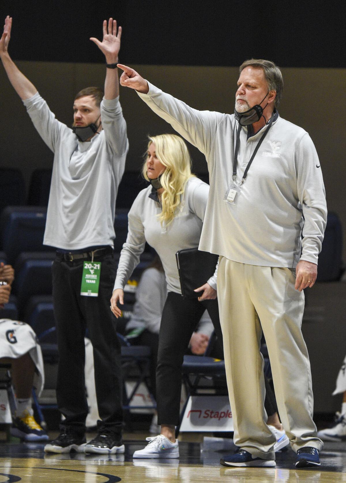West Virginia women's basketball head coach Mike Carey leads his team against the Texas Longhorns, at the WVU Coliseum in Morgantown, W.Va., Jan. 9, 2021.