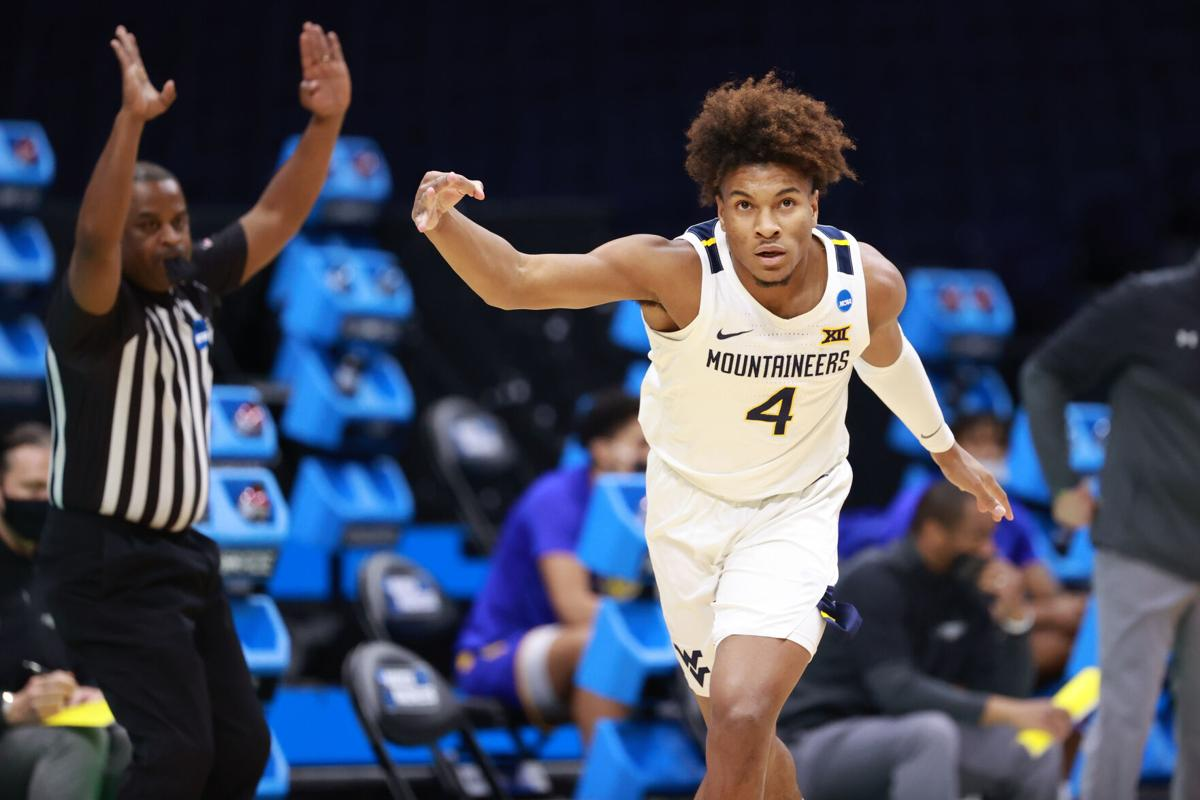 West Virginia guard Miles McBride celebrates following a made three-pointer against the Morehead State Eagles in the First Round of the NCAA Tournament in Indianapolis, Indiana, on March 19, 2021.
