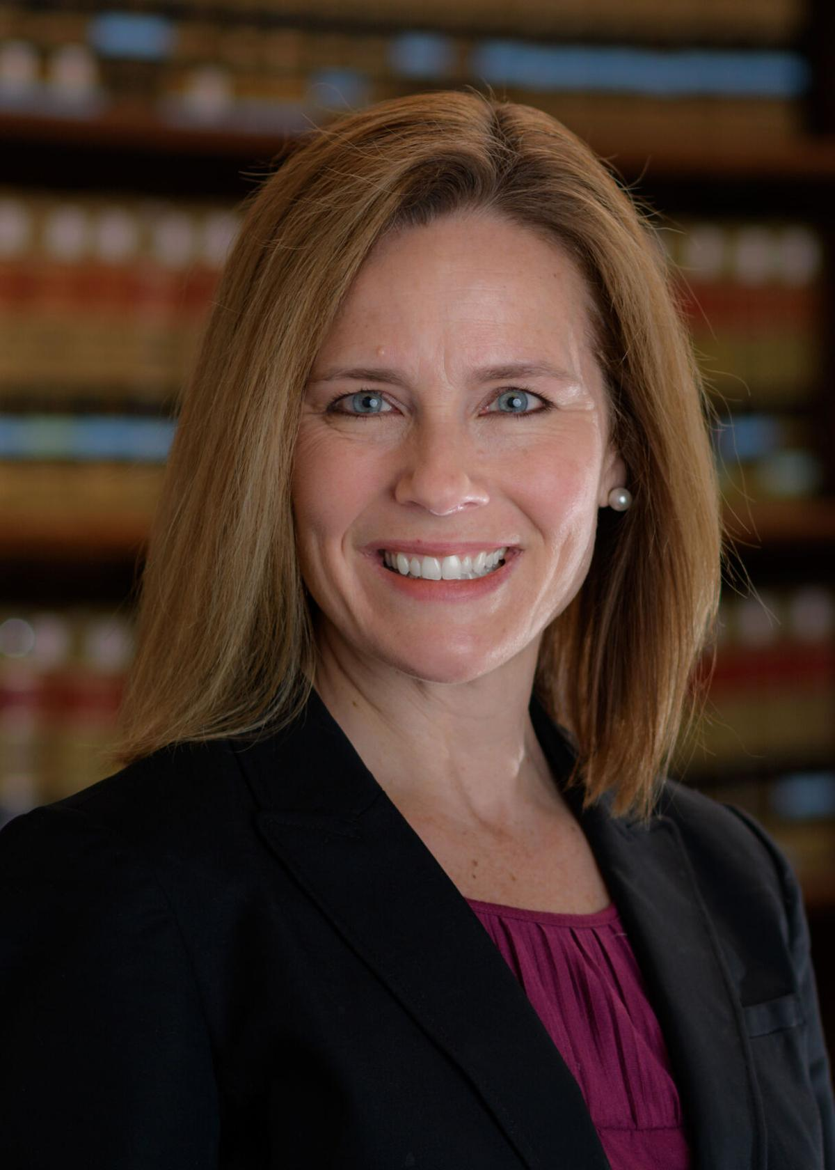 Amy Coney Barrett poses for a photo
