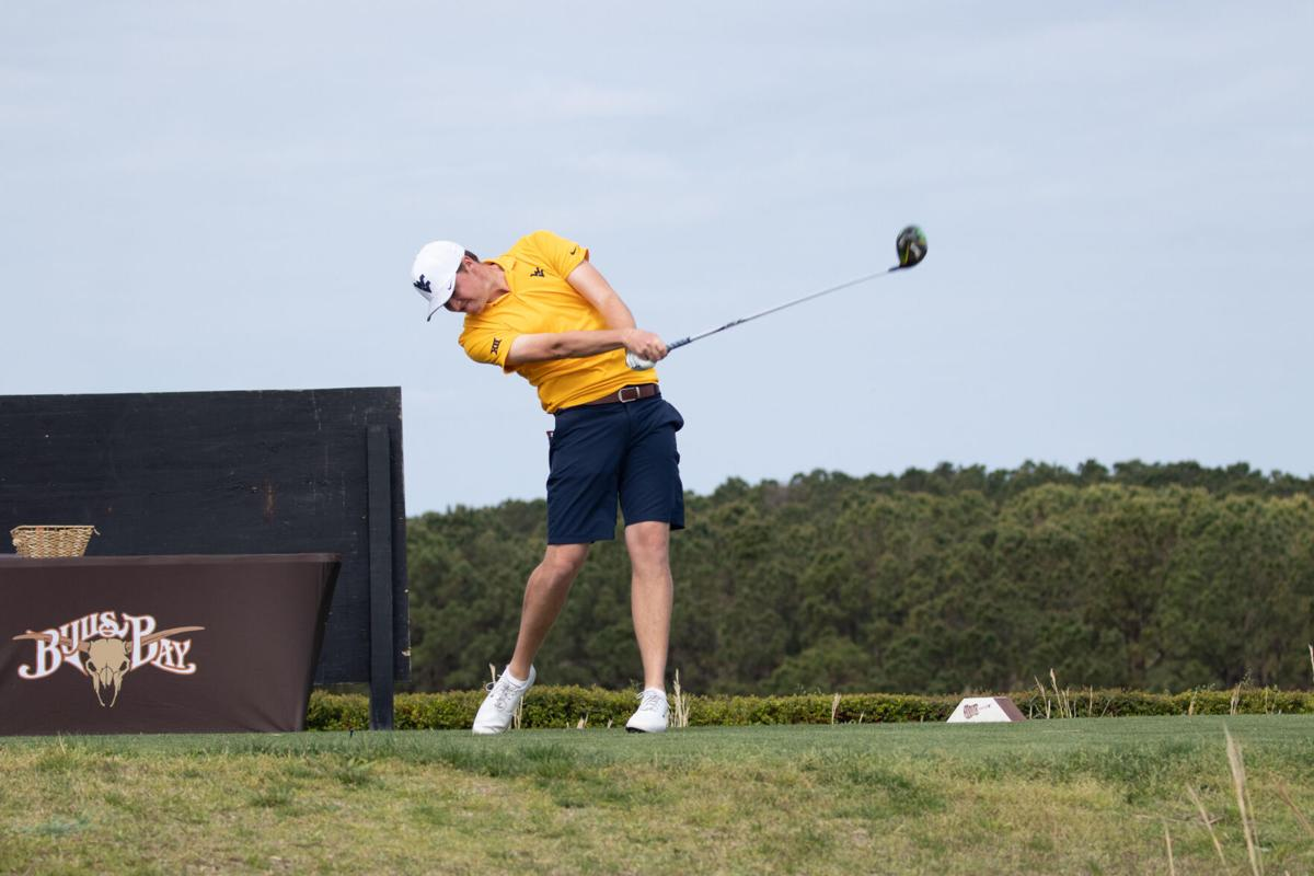 West Virginia golfer Trent Tipton tees-off during competition.