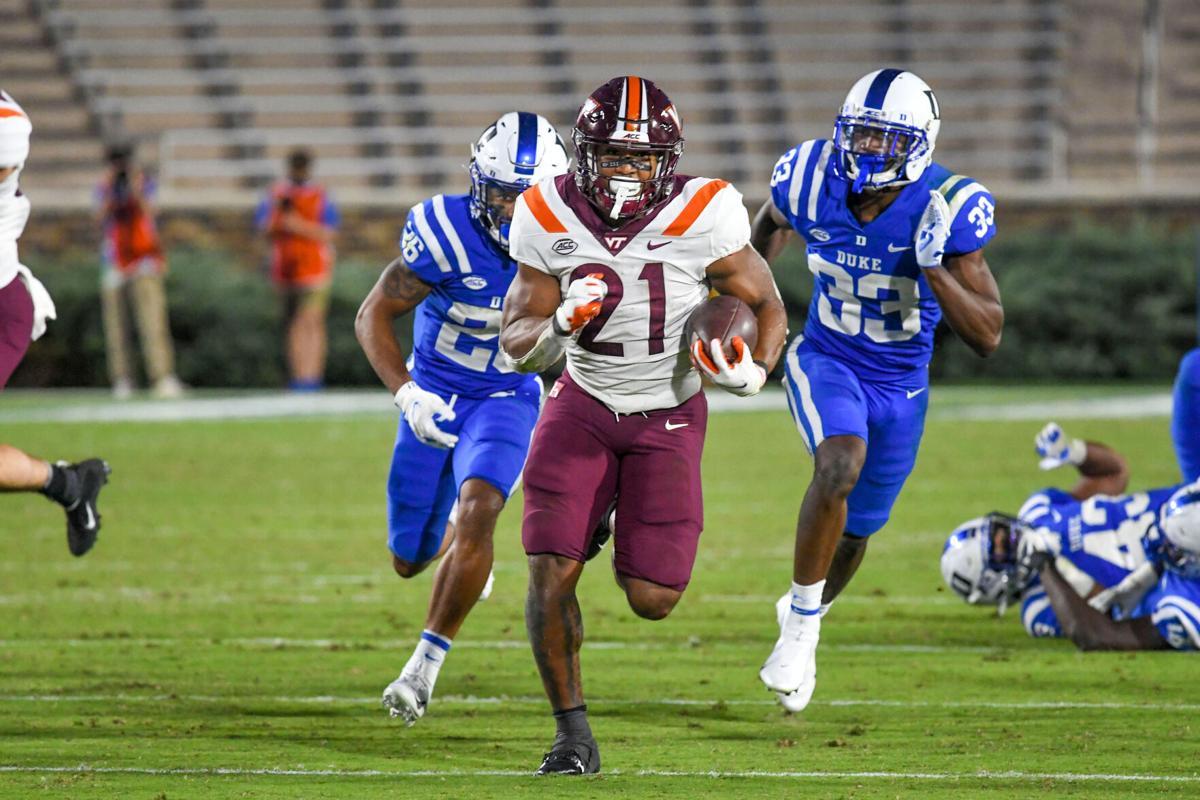 Virginia Tech running back Khalil Herbert (21) breaks away from two Duke defenders on Oct. 3, 2020 in Durham, NC.