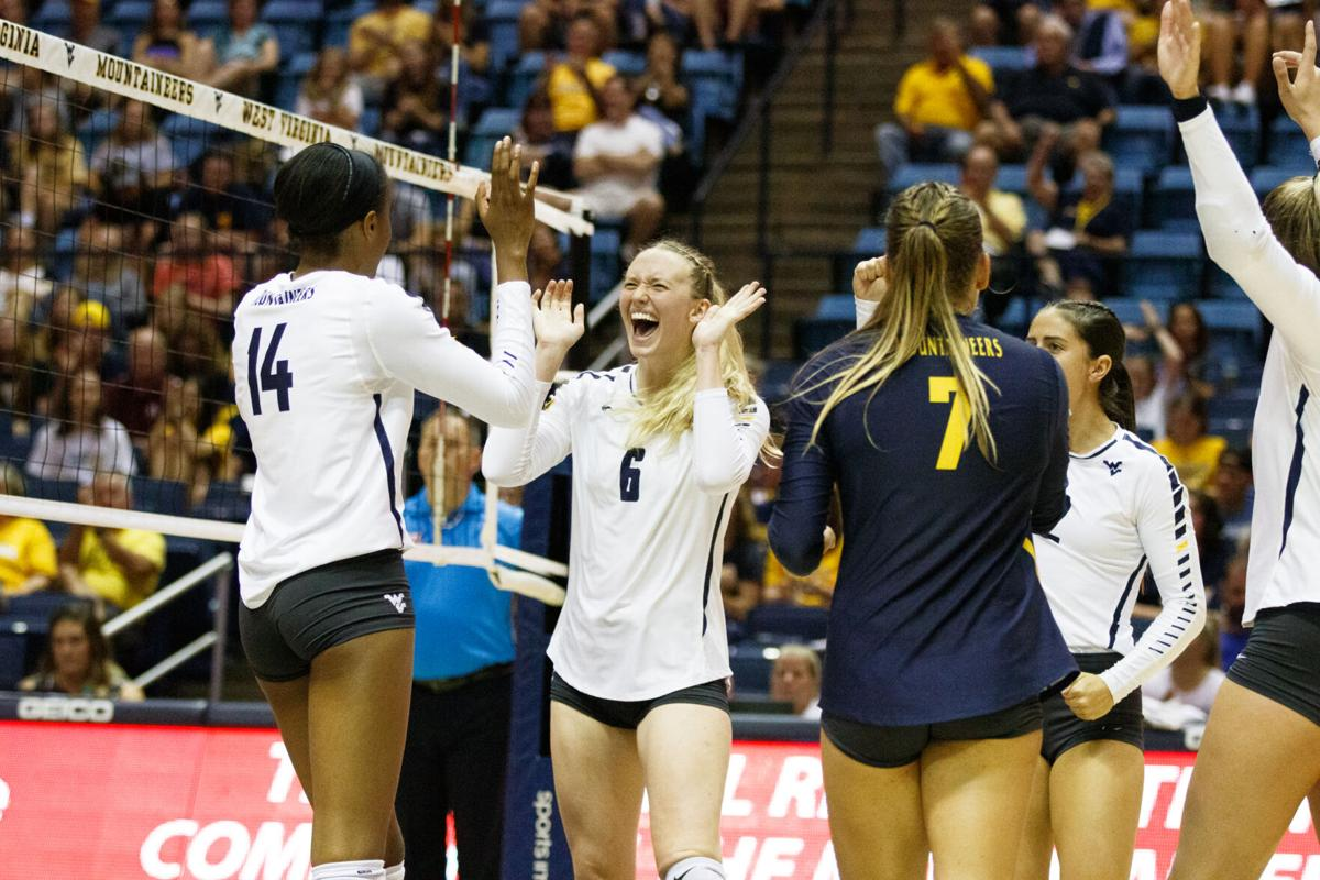 West Virginia's Lacey Zerwas (#6) celebrates a point during West Virginia's loss to Oklahoma 3-1 last year in Morgantown.