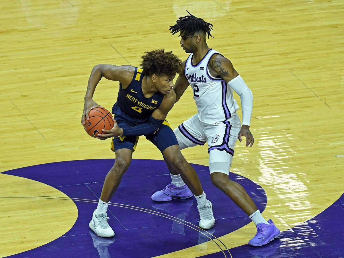 WVU guard Miles McBride (4) looks for an outlet against a Kansas State defender in WVU's victory against the Wildcats on Jan. 23, 2021.