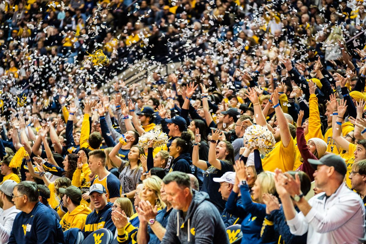 Fans throw confetti after WVU scored first against Oklahoma on February 29, 2020 at the WVU Coliseum.