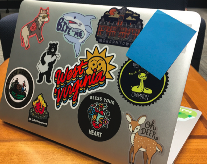 Laptop stickers showing the uniqueness of the WVU student population.