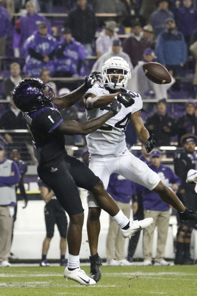 West Virginia cornerback Hakeem Bailey deflects a pass intended for TCU wide receiver Jalen Reagor at Amon G. Carter Stadium on Nov. 29, 2019.