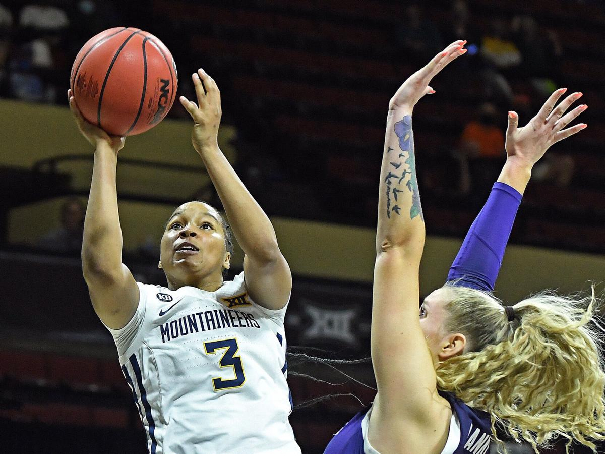 West Virginia guard Kirsten Deans (3) shoots the game-winning layup against the Kansas State Wildcats in the quarterfinal round of the Big 12 Tournament on March 12, 2021, in Kansas City, Missouri.