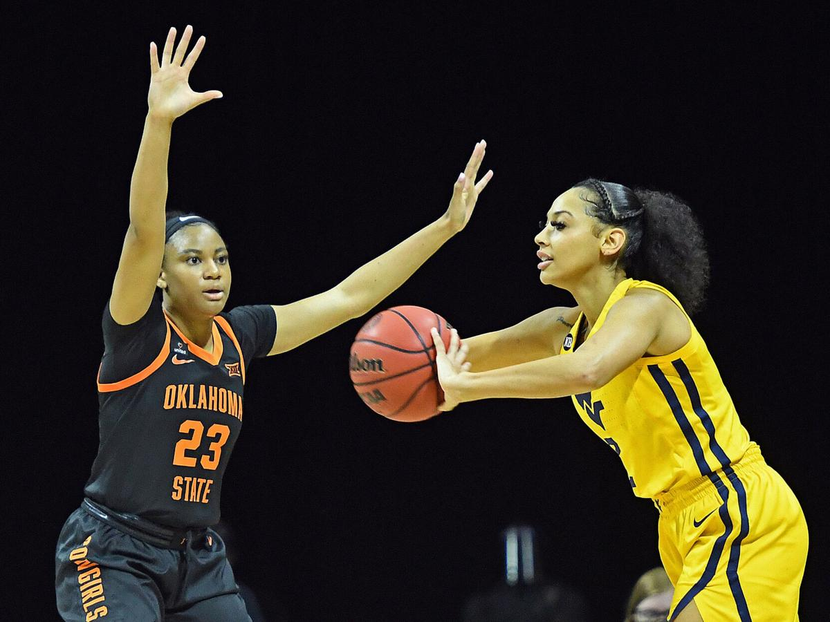 West Virginia guard Kysre Gondrezick looks to pass against the Oklahoma State Cowgirls in the Big 12 Conference Tournament in Kansas City, Missouri, on March 13, 2021.