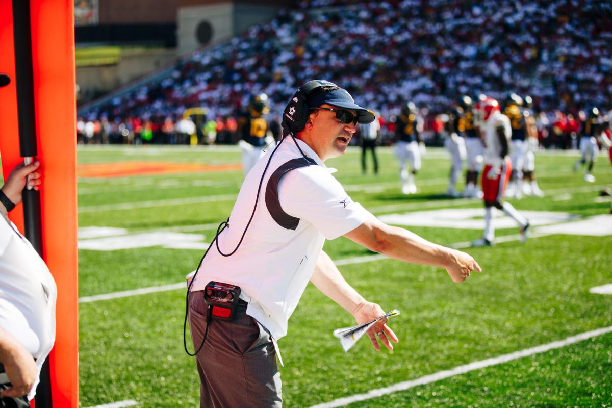 West Virginia head coach Neal Brown discusses a call with an official during the first half of the game between the West Virginia Mountaineers and the Maryland Terrapins at Capital One Field at Maryland Stadium in College Park, MD on Sept. 4, 2021