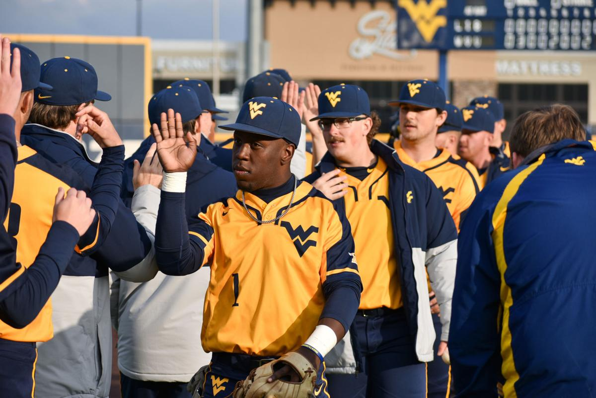 Mar. 11, 2020 - Mountaineers high five each other after defeating Liberty 7-0