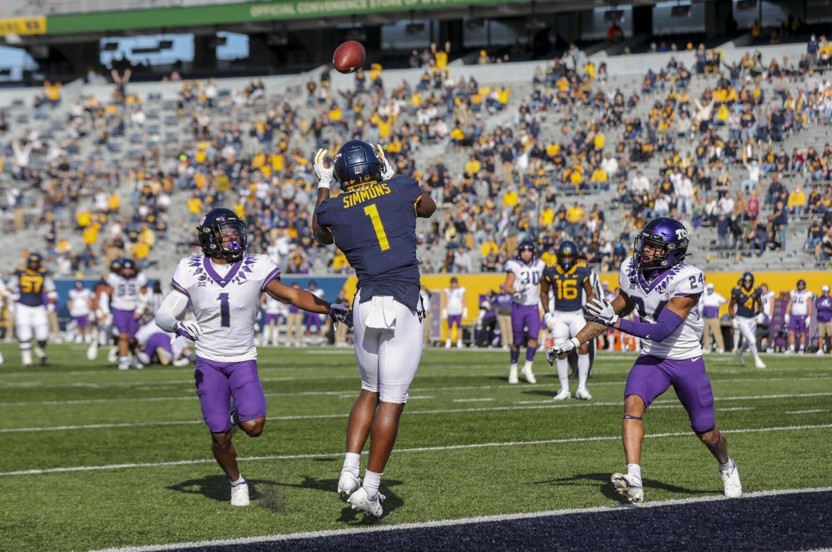 Nov 14, 2020; Morgantown, West Virginia, USA; West Virginia Mountaineers wide receiver T.J. Simmons (1) catches a touchdown pass during the second quarter against the TCU Horned Frogs at Mountaineer Field at Milan Puskar Stadium.