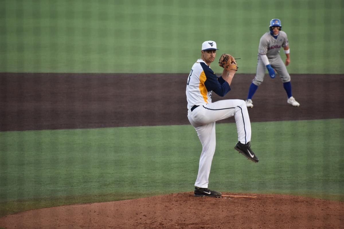 Jackson Wolf winds up his pitch versus Kansas at the Monongalia County Ballpark in Morgantown, W.Va., March 26 2021.
