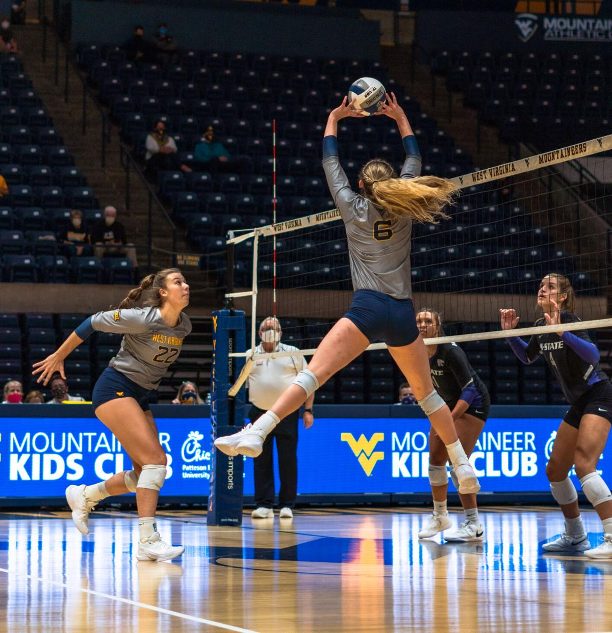 Lacey Zerwas (6) sets the ball to Audrey Adams (22) against Kansas State on Oct. 1, 2020 at the WVU Coliseum.