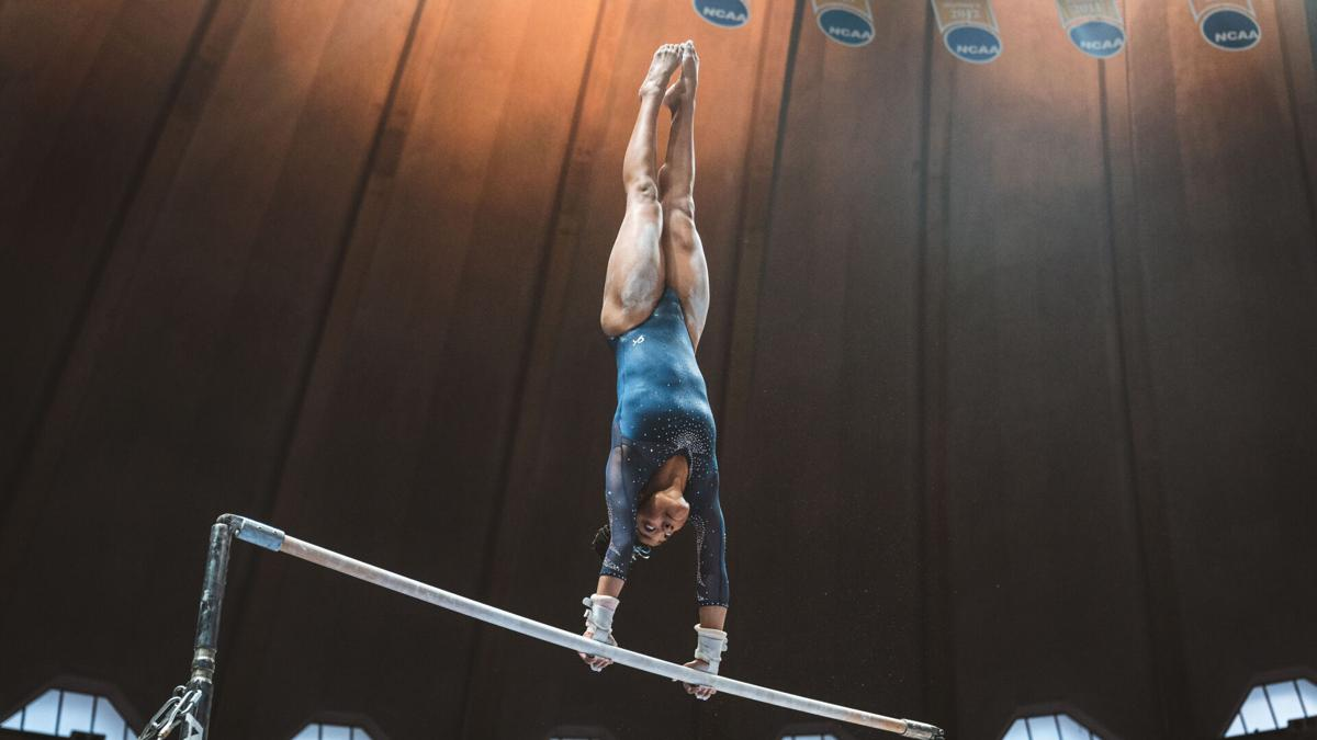 West Virginia's Kiana Lewis competes during a gymnastics meet for the Mountaineers.