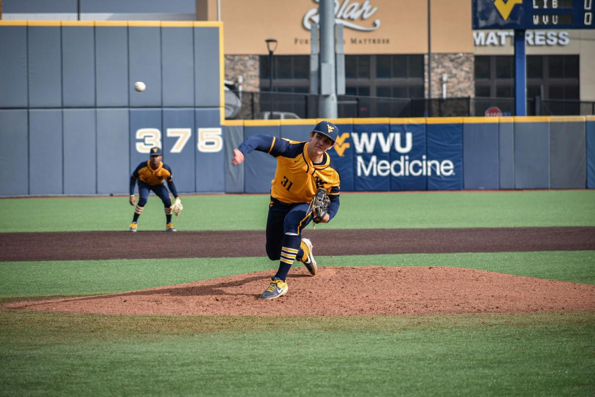 Mar. 11, 2020 - Freshman Pitcher Tyler Strechay throws a pitch against Liberty at Monongalia County Ballpark