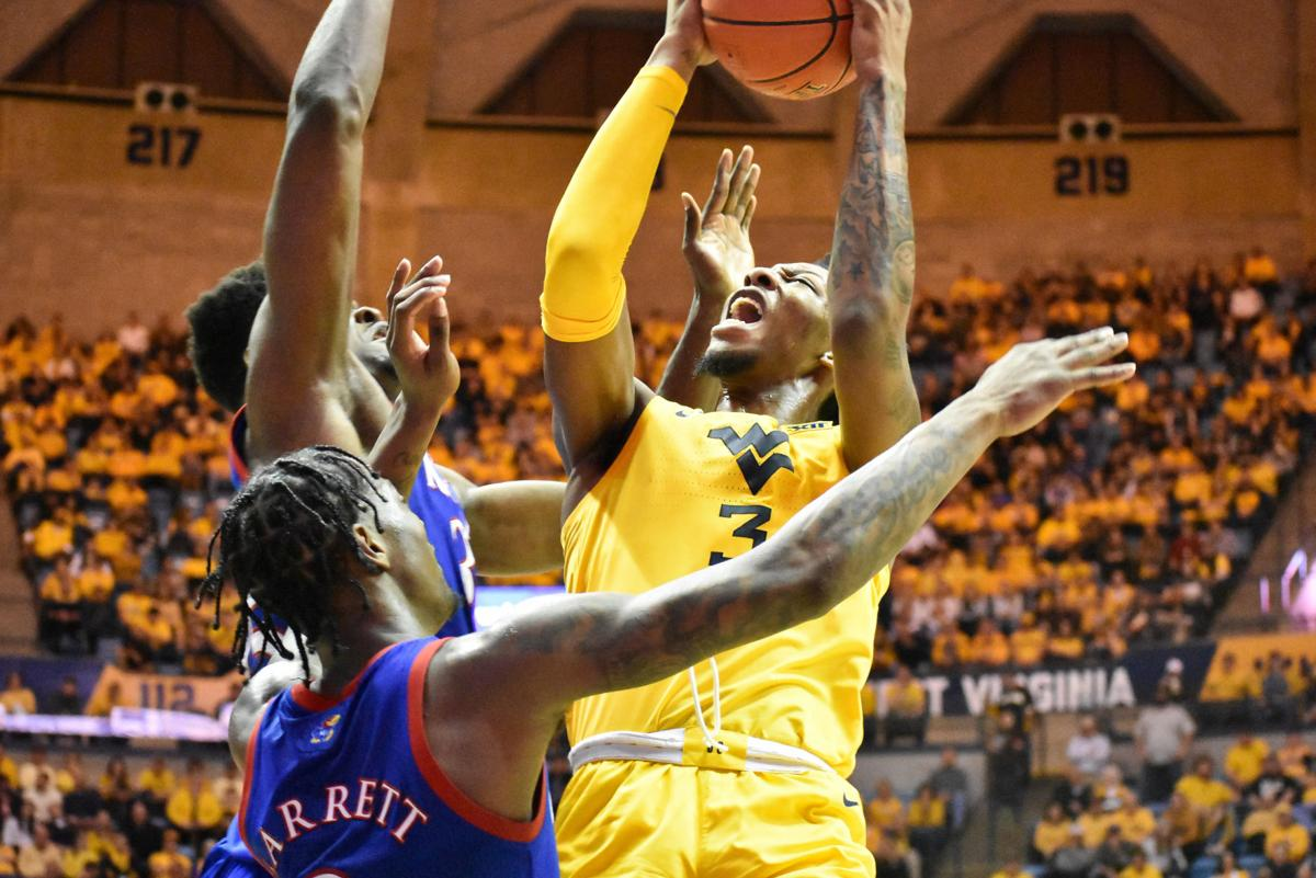 West Virginia forward Gabe Osabuohien goes up for a layup while two Kansas players defend at the WVU Coliseum on Feb. 12, 2020.