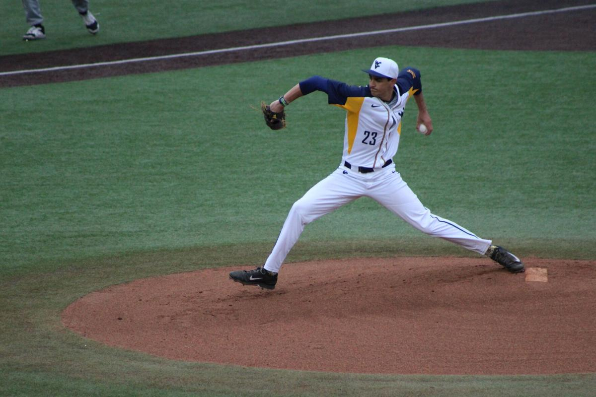 Jackson Wolf mid pitch in a game versus Texas Tech on April 16, 2021 at the Monongalia County Ballpark in Morgantown W.Va.