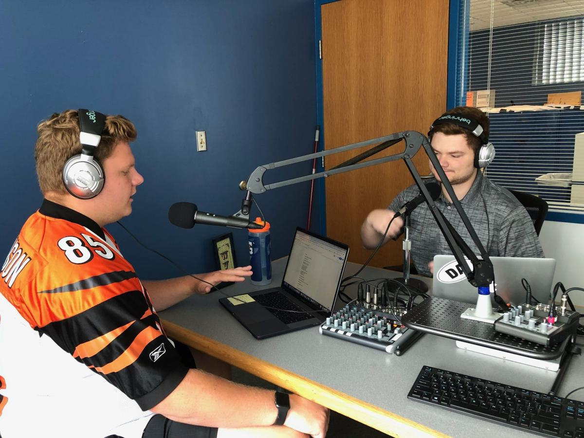 Nick and Cody recording their podcast