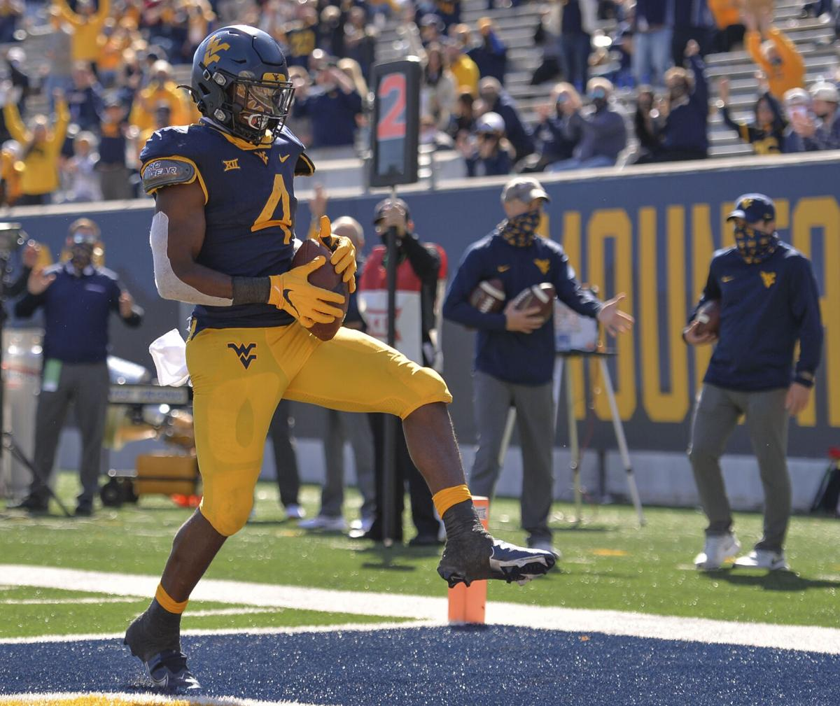 West Virginia Mountaineers running back Leddie Brown (4) makes a catch for a touchdown against the Kansas Jayhawks Saturday, Oct. 16, 2020, in Morgantown.