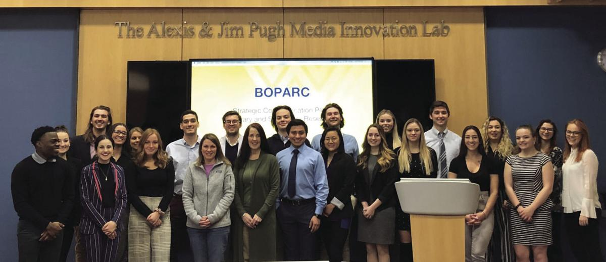 Students from the Martin Hall Agency pose with members from Morgantown's BOPARC after pitching their ideas to them.