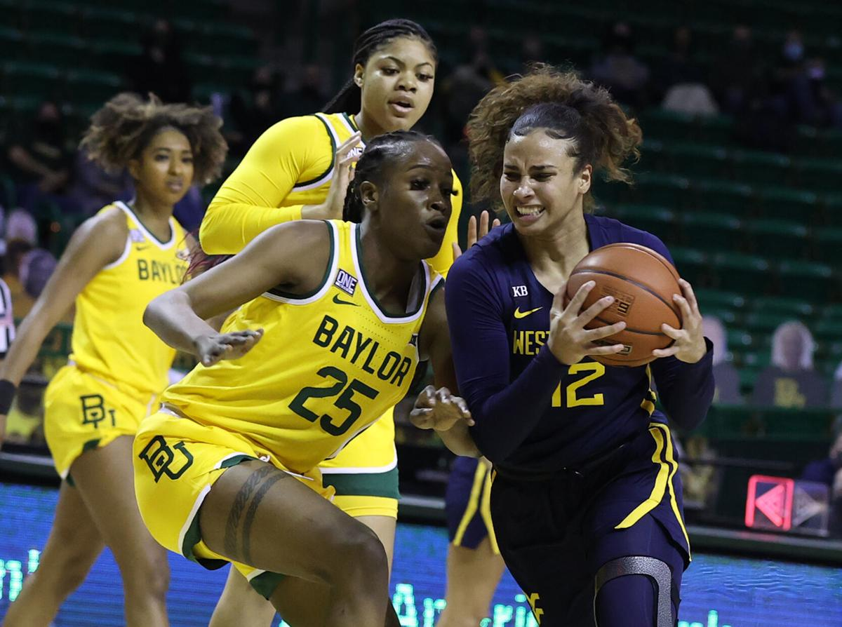West Virginia forward Esmery Martinez drives on Baylor center Queen Egbo in the first half.