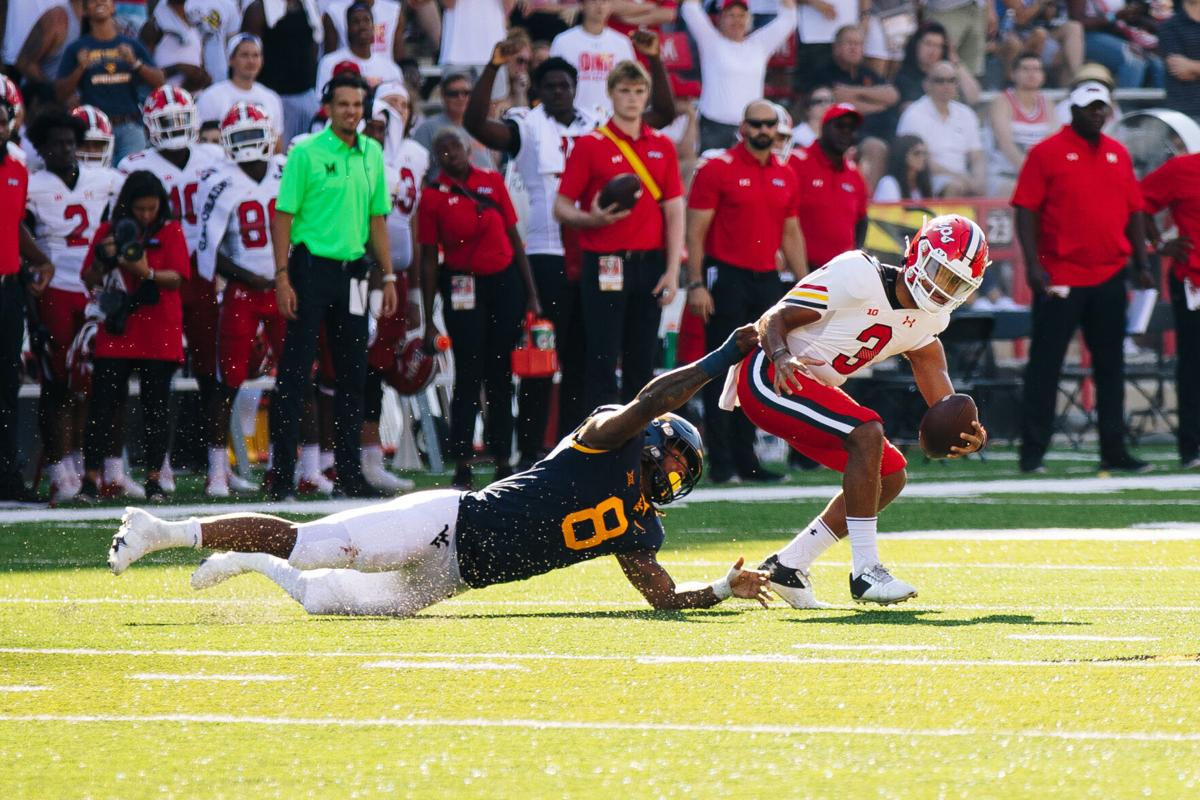 COLLEGE PARK, MD - SEPTEMBER 4: West Virginia bandit VanDarius Cowan tackles Maryland quarterback Taulia Tagovailoa during the first half of the game between the West Virginia Mountaineers and the Maryland Terrapins at Capital One Field at Maryland Stadium in College Park, MD on Sept. 4, 2021.