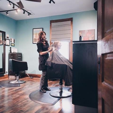 A Tonique's Trilogy stylist works with a client.