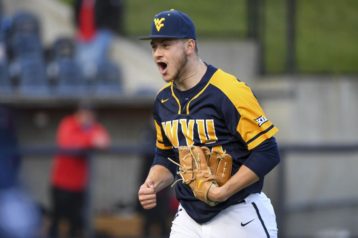 West Virginia pitcher Jacob Watters celebrates while walking off the field.