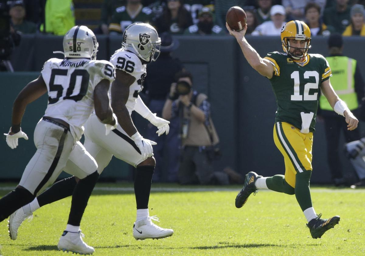 Rodgers torches Raiders