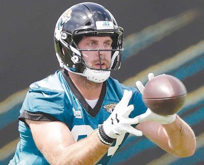 Jaguars bring back former Oiler Koyack