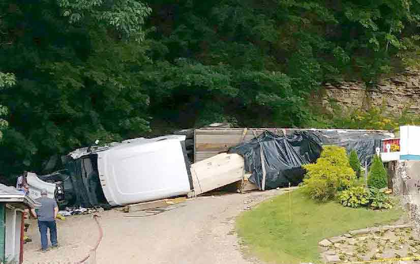 2 injured when tractor-trailer slams into Franklin building