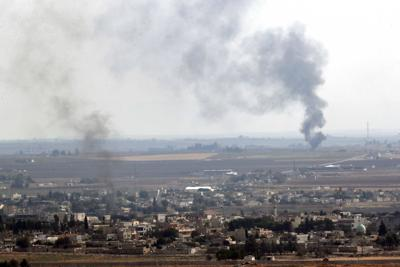 Kurds evacuate Syrian town