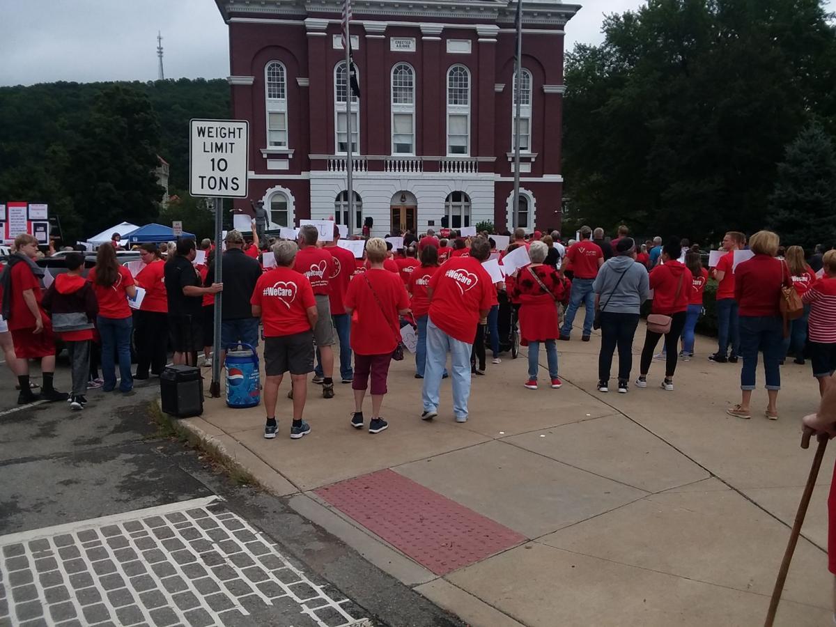 Hundreds rally to save Polk Center