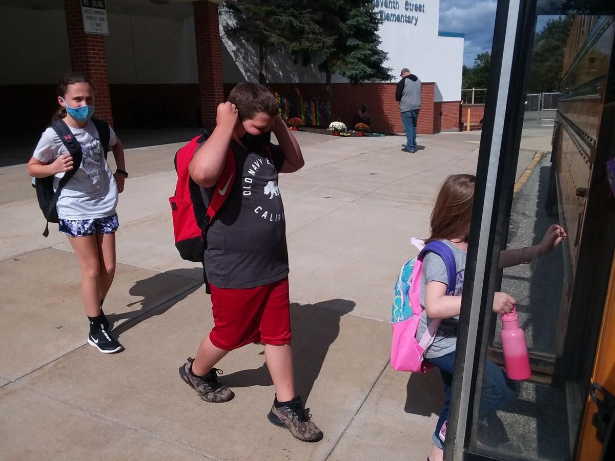 Oil City school students board the bus