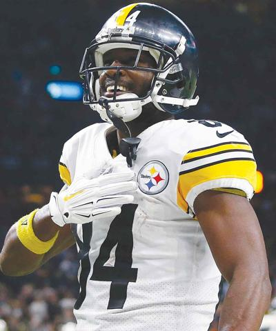 Tomlin stops short of saying Brown quit on Steelers
