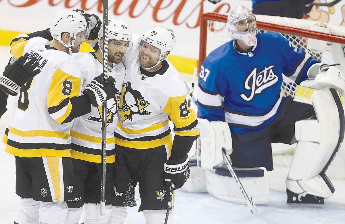 Penguins skate past Jets