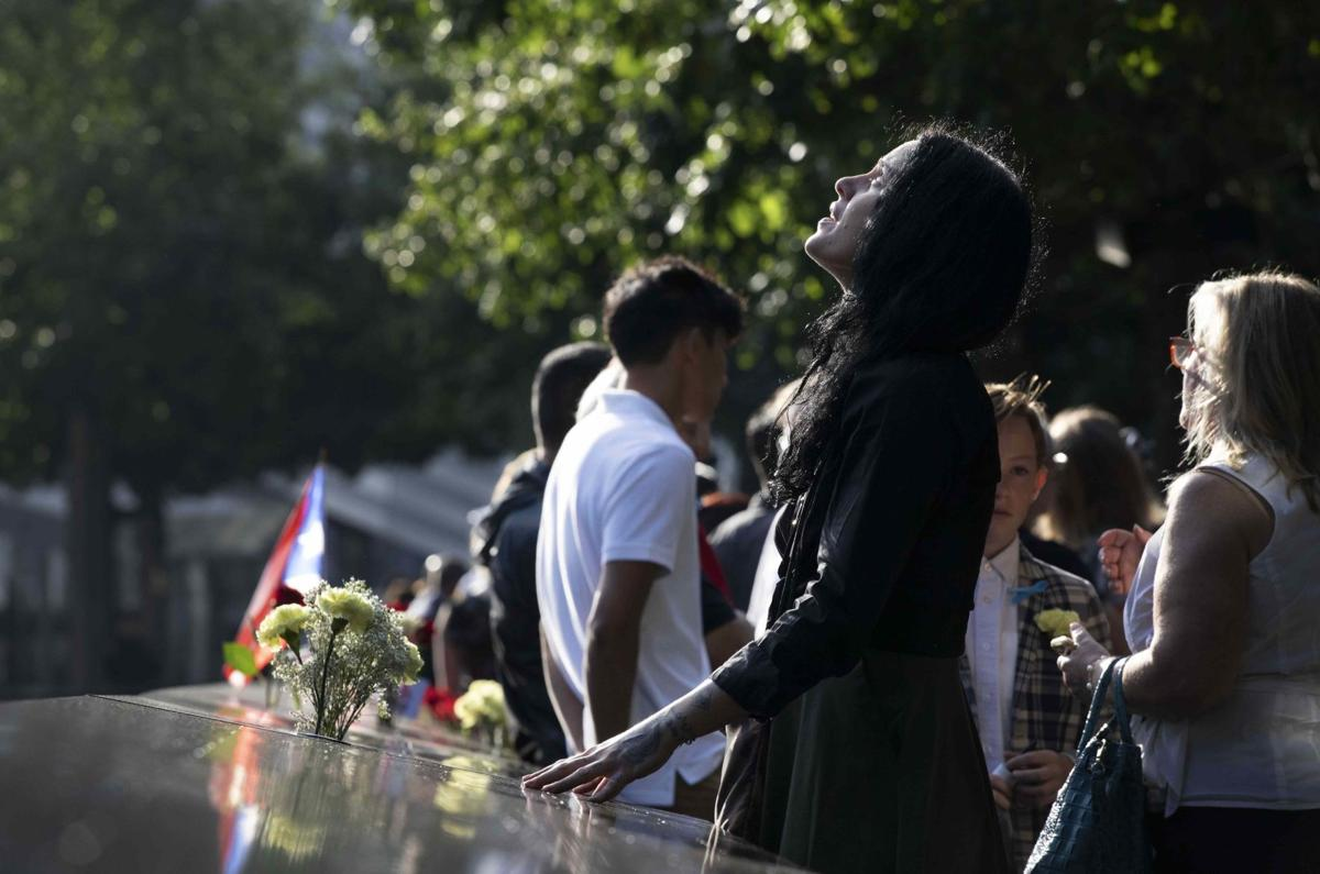 9/11 lost loved ones honored at solemn ceremonies