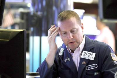 Stocks dip again on worries, capping wild week