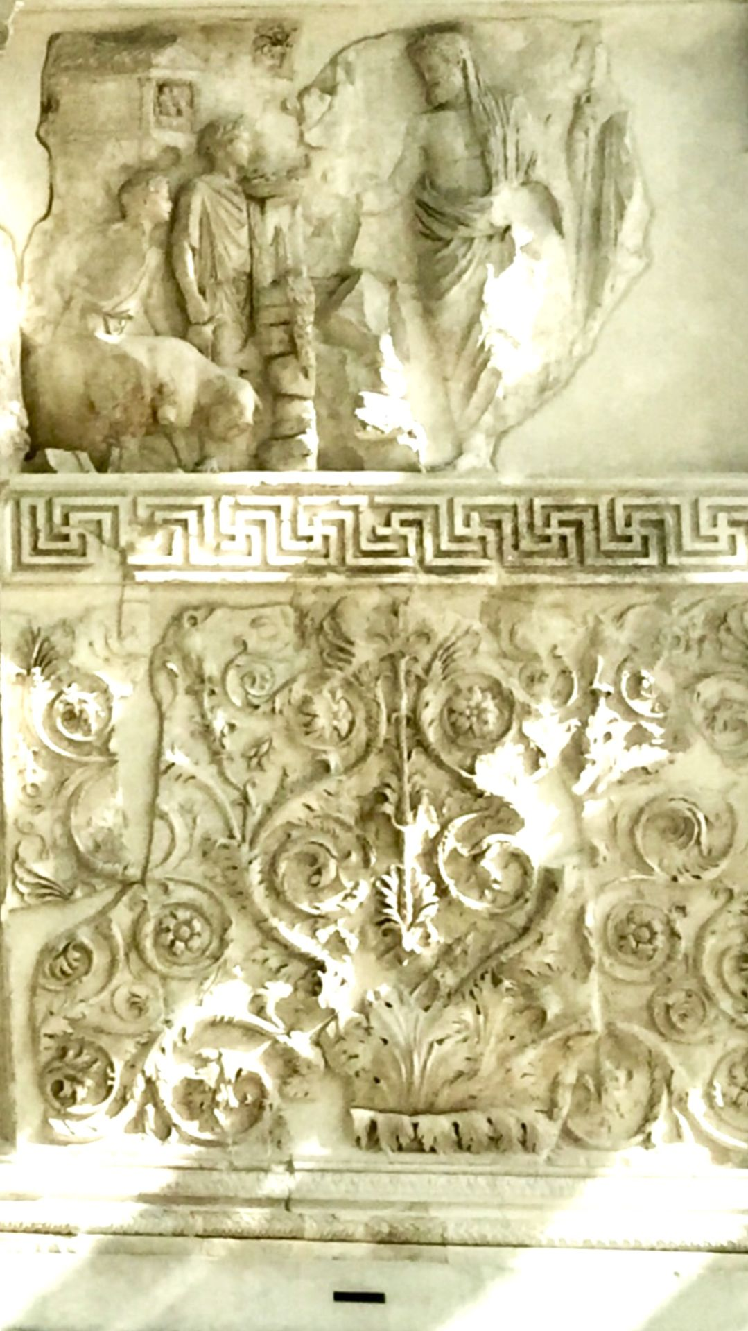 A frieze on the side of the altar