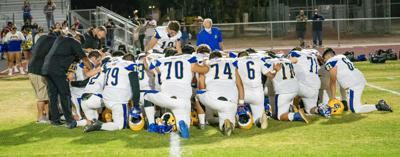 WILDCATS praying