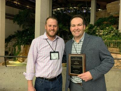 Scott Emanuelli with his award at the Western Seed Association convention.