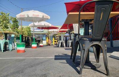 Outdoor seating by La Pergoletta