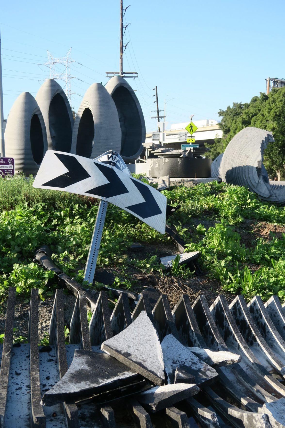 Damaged Cypress Park roundabout art artwork statues Jesus Sanchez 11-29-2019 4-10-31 PM.JPG