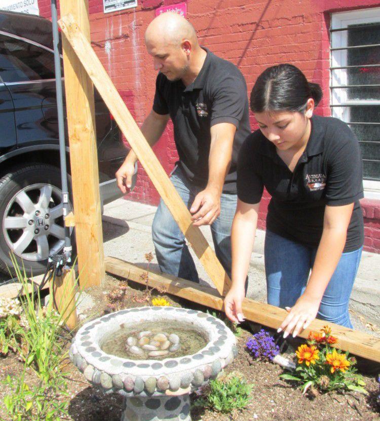 Miguel and Kathy Hernandez working the garden.jpg